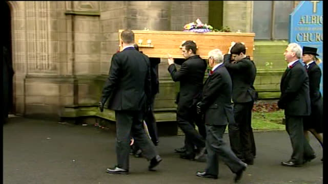 funeral of coronation street's bill tarmey; england: manchester: ashton under lyme: albion united reformed church: ext ** music heard intermittently... - soap opera stock videos & royalty-free footage