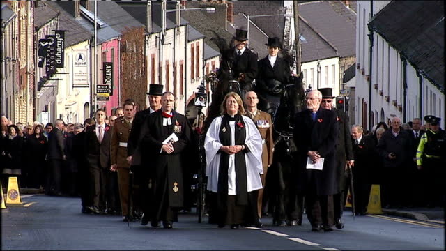 funeral of corporal channing day war memorial statue along side union jack flag family and friends of corporal channing day stand watching as british... - union army stock videos & royalty-free footage