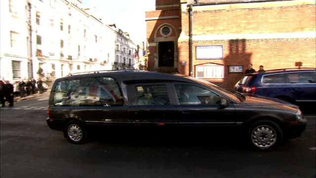 funeral of dday veteran 'escapee' bernard jordan and his wife irene england brighton ext hearse and outriders arrival at churtch / pallbearers behind... - hearse stock videos & royalty-free footage