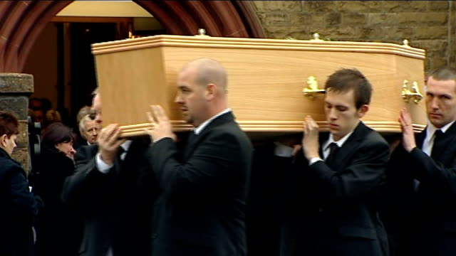 funeral of family killed in motorway crash; wales: llandudno: ext coffins of members of statham family carried from church, including coffins of... - doctor who stock videos & royalty-free footage