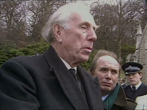 funeral of former art advisor to the queen and spy anthony blunt; a) england: london: putney vale: ext coffin carried into church pull out bunches of... - itv news at five stock videos & royalty-free footage