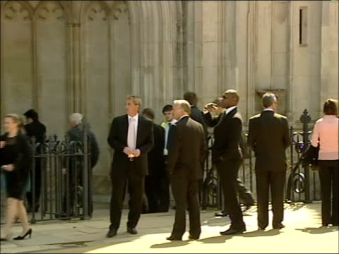 funeral of former england footballer alan ball; int mourners along through cathedral door ext charlton greeting congregation members at church porch... - greeting stock videos & royalty-free footage