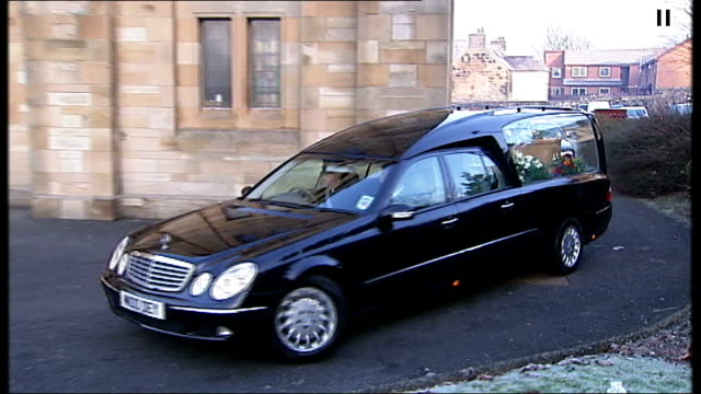 paisley int funeral of singer gerry rafferty pamphlet for requiem mass and coffin arriving at cathedral in hearse people outside cathedral - pamphlet stock videos & royalty-free footage