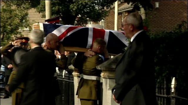 funeral of kingsman darren deedy england greater manchester bolton ext union jack draped coffin of kingsman darren deedy carried into church by... - bolton greater manchester stock videos and b-roll footage