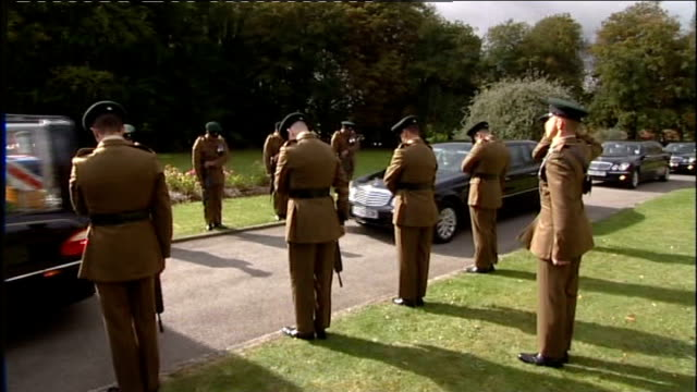 funeral of lance corporal jonathan mckinlay england wiltshire bulford camp ext hearse carrying coffin of lance corporal jonathan mckinlay along to... - lowering stock videos & royalty-free footage