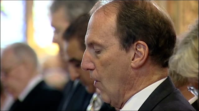 funeral of liberal politician cyril smith close shots simon hughes mp singing hymn sot / various of other members of congregation singing sot - cyril smith politician stock videos & royalty-free footage