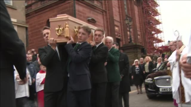 Funeral of 'Lisbon Lions' legend Billy McNeill SCOTLAND Glasgow EXT Mourners outside church at funeral of Billy McNeill including Kenny Dalglish Sir...