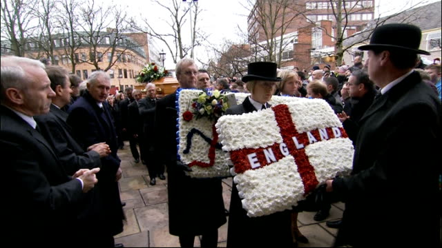 funeral of nat lofthouse held in bolton england greater manchester bolton ext people lined up and applauding as coffin of former bolton wanderers and... - bolton greater manchester stock videos and b-roll footage
