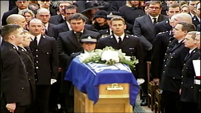 funeral of pc sharon beshenivsky held in bradford ext teresa milburn places pc beshenivsky's hat on her coffin cms police hat on coffin ms pc milburn... - pc sharon beshenivsky stock videos & royalty-free footage