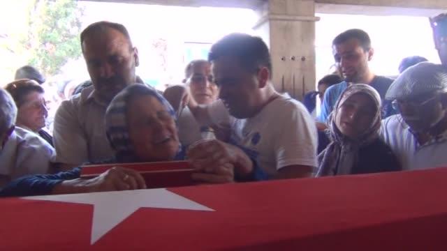 Funeral of police officer Mehmet Uyar killed in armed terrorist attack in Cinar district of Diyarbakir is held on July 30 2015 in Salihli district...