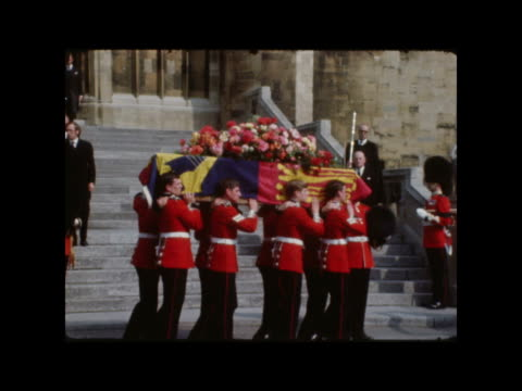 funeral of prince william of gloucester; england: windsor crowds waiting: coffin carried out of cathedral: closer view of coffin: guards and church... - berkshire england stock videos & royalty-free footage
