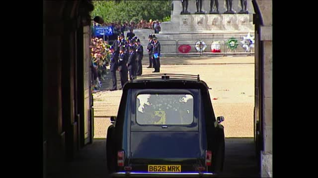 funeral of princess diana: coffin leaves westminster abbey; england: london: westminster: ext door of hearse of diana, princess of wales closed as... - funeral stock videos & royalty-free footage
