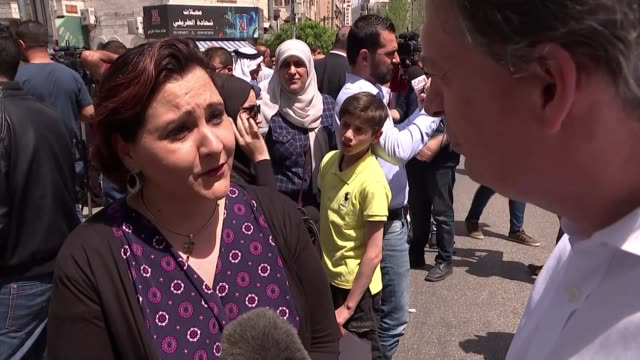 Funeral of prominent Palestinian journalist West Bank EXT Nour Odeh interview SOT Mustafa Barghouti interview SOT