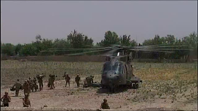 funeral of royal marine killed in afghanistan t27071133 helmand province nahresaraj district ext exterior wall of base with items stored beneath... - helicopter rotors stock videos and b-roll footage