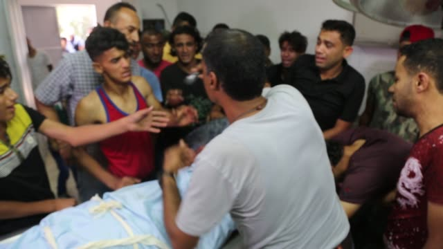 Funeral of Sabri Abu Khadir 24 mourns over his body at the morgue of AlShifa Hospital in Gaza City on June 18 2018 A Palestinian was killed by...