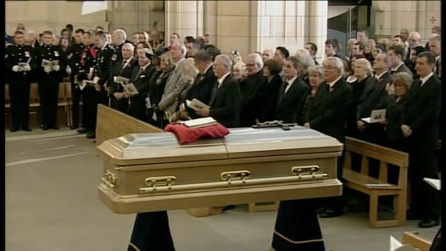 funeral of sir jimmy savile int clergy along inside cathedral coffin in front of congregation alison graham speaking during funeral service sot so... - ジミー サヴィル点の映像素材/bロール