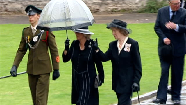 funeral of world war one veteran harry patch; england: somerset: wells: wells cathedral: ext / raining camilla, the duchess of cornwall shaking hands... - wells cathedral stock videos & royalty-free footage