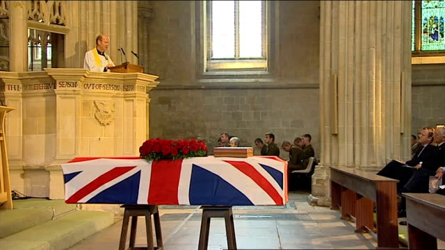 funeral of world war one veteran harry patch int clarke delivering funeral eulogy from pulpit coffin in foreground sot / clarke speaking from pulpit... - eulogy stock videos & royalty-free footage