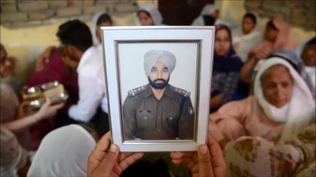 Funeral proceedings take place in Sathiala village for Raghbir Singh a member of the Indian Central Reserve Police Force who was killed in a Maoist...
