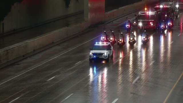 Funeral Procession for Lt Matthew LeTourneau drives in heavy rainfall Southbound on I95 in Philadelphia PA towards St Peter and Paul Cemetery in...
