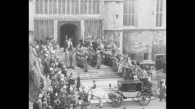 funeral procession of king george v arrives at st. george's chapel at windsor castle / pallbearers remove coffin from gun carriage / bagpipes playing... - 甥点の映像素材/bロール