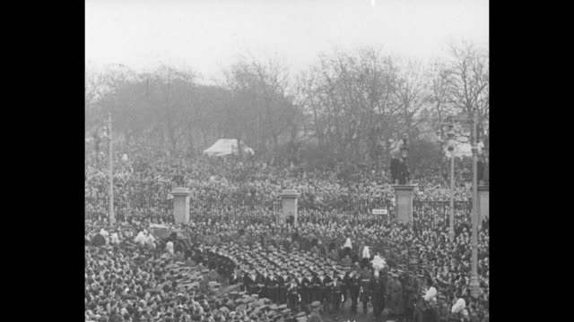funeral procession of king george v leaves westminster hall / coffin draped with royal standard on gun carriage carried by british sailors / coffin... - sphere stock videos & royalty-free footage