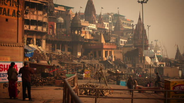funeral pyres on the ghats beside the holy river ganges - indian arrowhead stock videos and b-roll footage