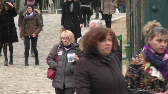 stockvideo's en b-roll-footage met a funeral service was held on friday for a lesser known charlie hebdo cartoonist philippe honore who lost his life in the attack on the satirical... - cartoonist