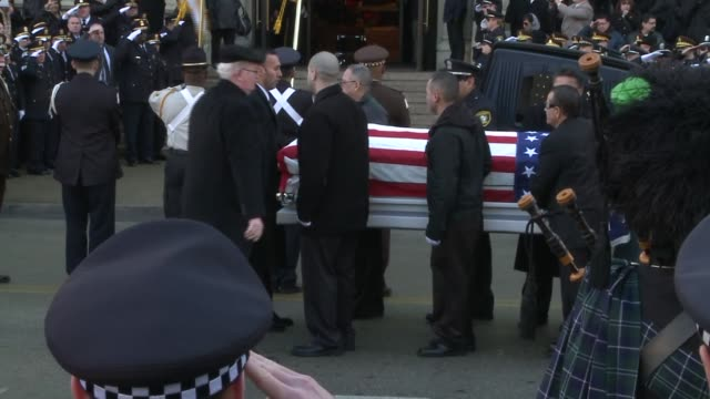 funeral services were held for slain cook county sheriff's investigator cuauhtemoc estrada estrada was killed while hosting a christmas party he... - pompe funebri video stock e b–roll