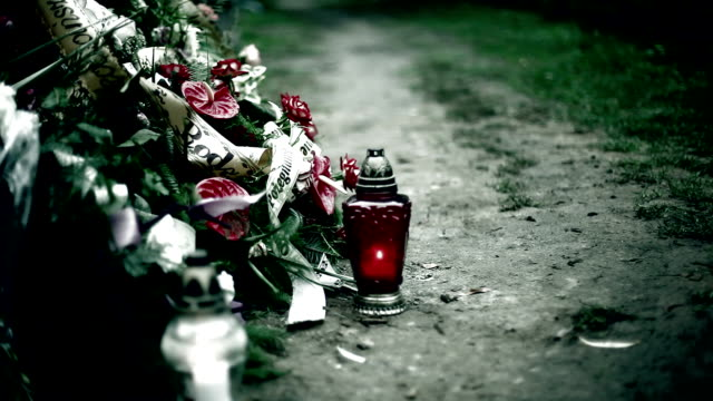 funeral, wreath and candle on the grave - funeral stock videos & royalty-free footage