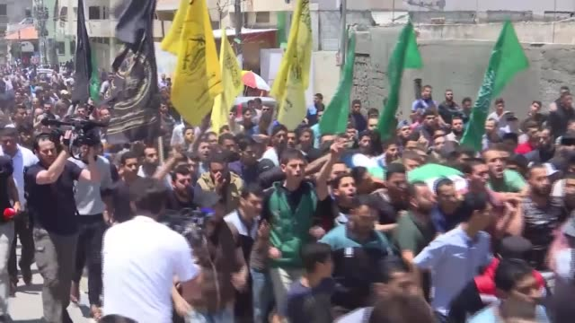 Funerals held for Palestinians killed during protests against opening of US embassy in Jerusalem Gaza EXT Various shots of partially covered dead...