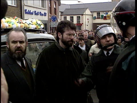 funerals; northern ireland: coalisland tgv procession at funeral of kevin barry o'donnell zoom in tcs beret, gloves and belt on irish flag on coffin... - catholicism stock videos & royalty-free footage