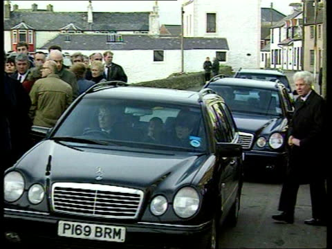 funerals of fisherman held itn scotland isle of whithorn ext gv cars carrying families of dead fishermen towards past mourners to funeral side... - solway harvester stock videos and b-roll footage