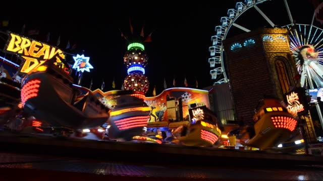 funfair carnival ride at christmas market berlin - swing tanz stock-videos und b-roll-filmmaterial