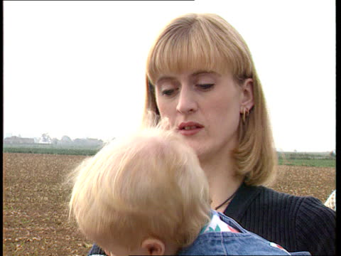 fungicide link to eyeless children england lincs debbie paul thompson standing in the garden debbie holding their eyeless baby daughter abby cms baby... - itv news at ten stock videos & royalty-free footage