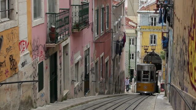 ws funicular elevador da bica climbing up narrow street / lisbon, portugal - steep stock videos & royalty-free footage