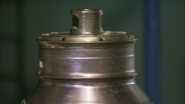 a funnel-shaped cylinder spins. - cylinder stock videos & royalty-free footage