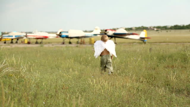 funny angel on the airfield