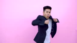 Funny Asian Young Man Doing Kung Fu Moves.