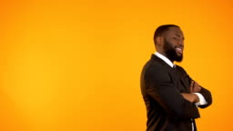 Funny black guy in formalwear dancing, isolated on orange background, template