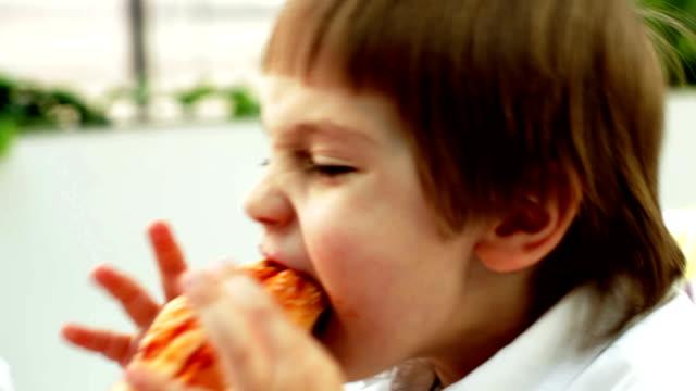 funny boy eating hamburger
