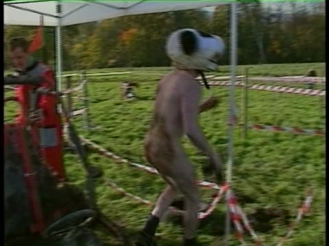 funny clip of a guy driving a gokart around a muddy track in the nude - naked stock videos & royalty-free footage