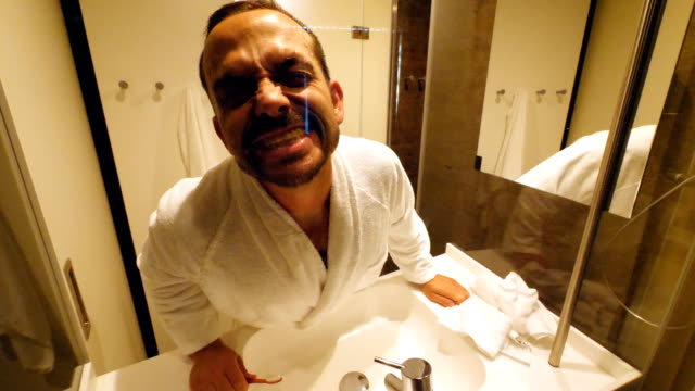 funny clip of man in the bathroom during his waking up routine - bathrobe stock videos & royalty-free footage