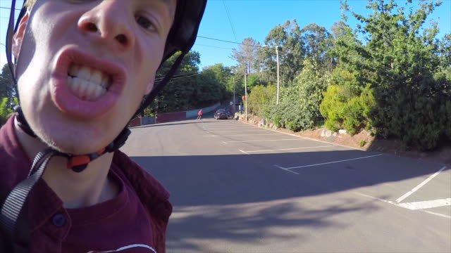 A funny expression on a skateboarder.