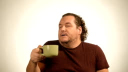 Funny fat guy eating a chocolate cake.