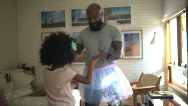 funny father with tutu skirts dancing like ballerinas - home interior stock videos & royalty-free footage
