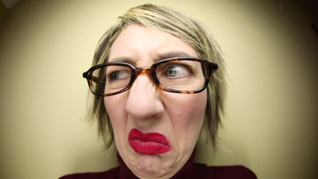 funny fisheye woman smelling something stinky - smelling stock videos & royalty-free footage