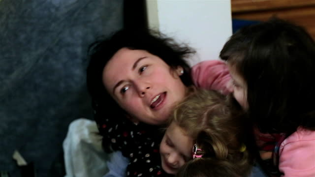 funny games. the sisters are having fun with their aunt. - aunt stock videos & royalty-free footage