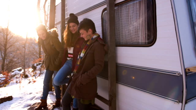 funny girlfriends in front of a camper trailer - camper trailer stock videos and b-roll footage