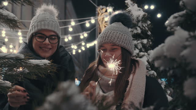 funny girls holding burning sparklers a new year celebration - human face video stock e b–roll